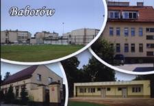 Baborów. Widok ogólny na budynki Zespołu Szkolno-Przedszkolnego, siedzibę Urzędu Miasta, Zakładu Usług Komunalnych oraz szatnię sportową.